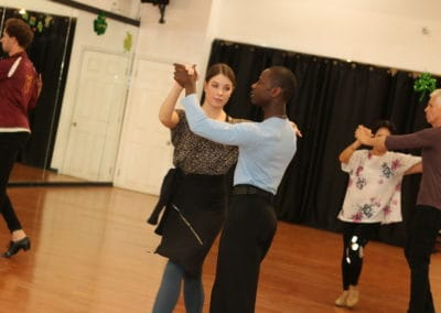 Instructor and student dancing