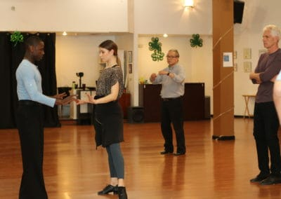 Dance class instructor and students
